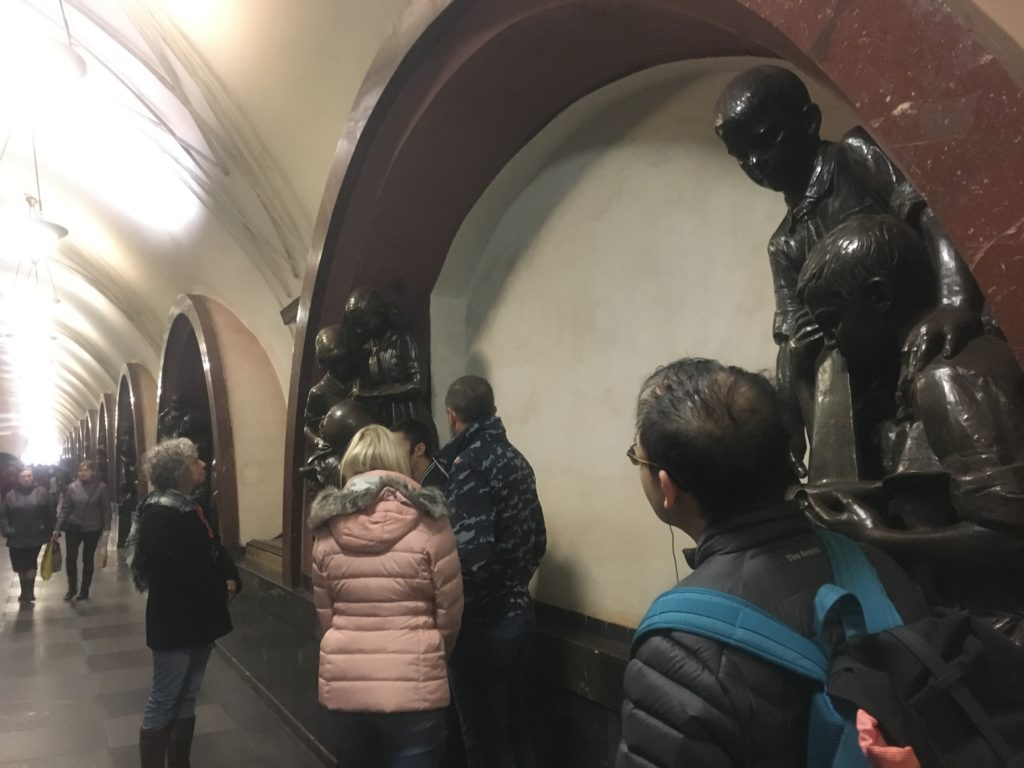 Family sculptures in Revolution Square Station Moscow