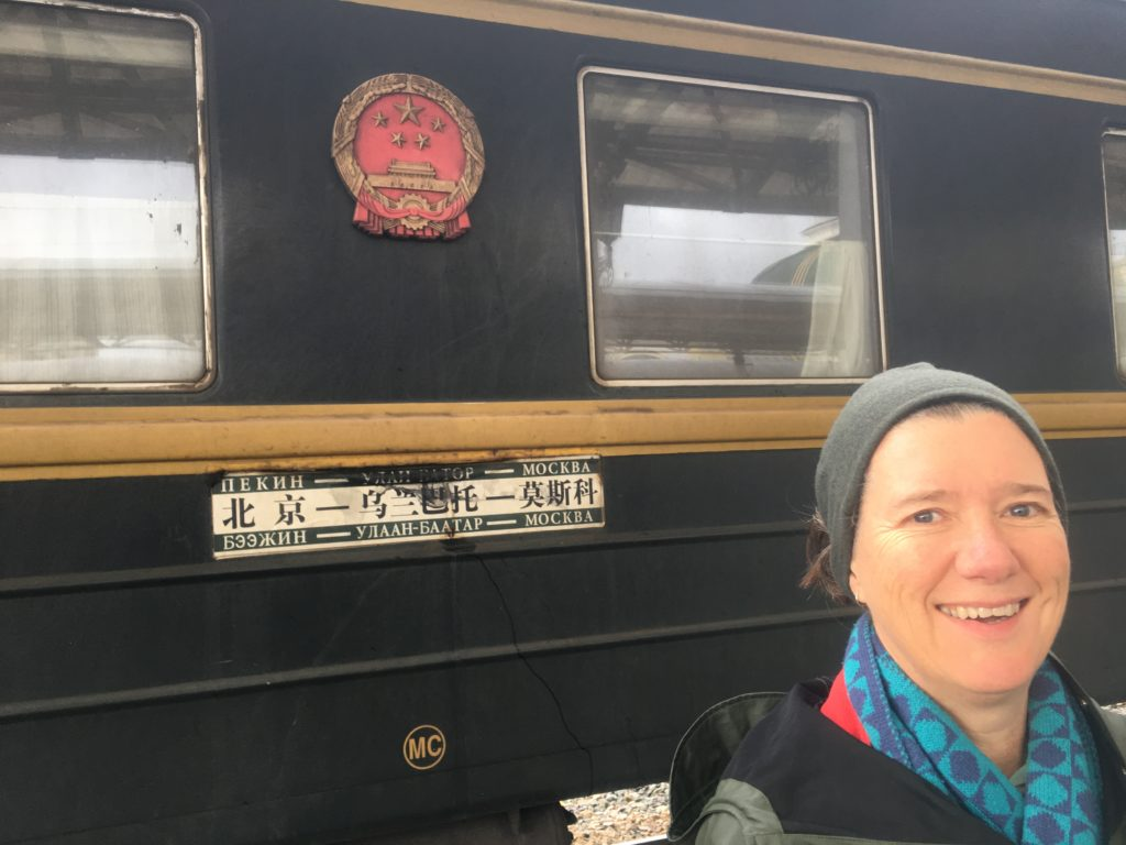 Victoria outside Chinese carriage on the TransSiberian/transMongolian Railway