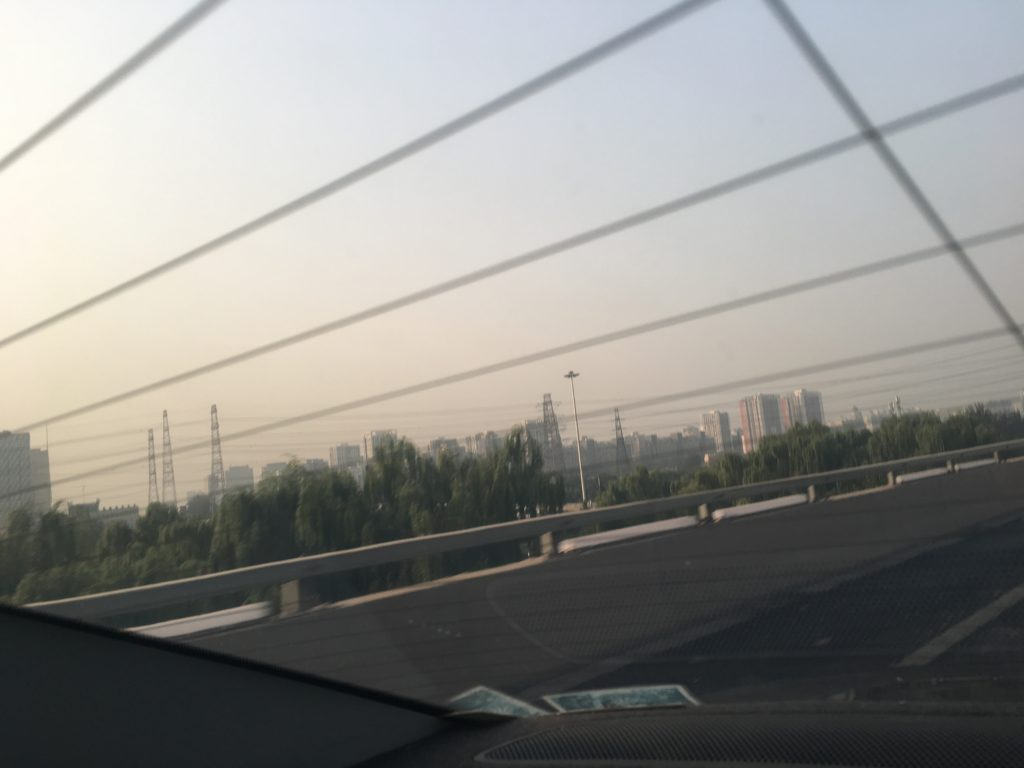 Driving out of Beijing, looking back at the fringe of the city