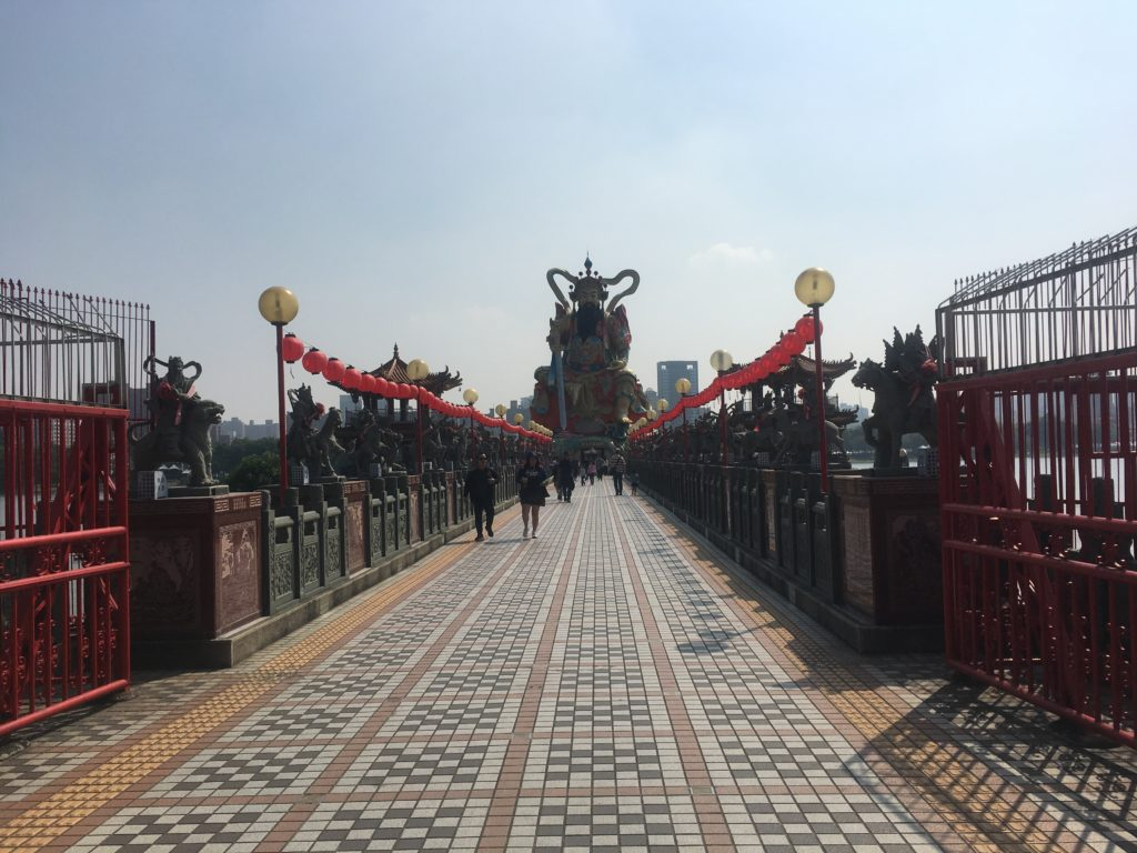 The bridge to this temple is guarded by a pantheon of Gods riding different animals