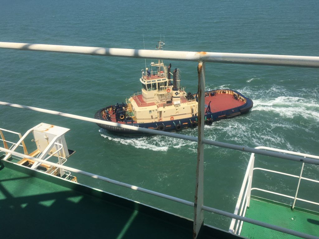 Tug bringing CC Coral into Brisbane