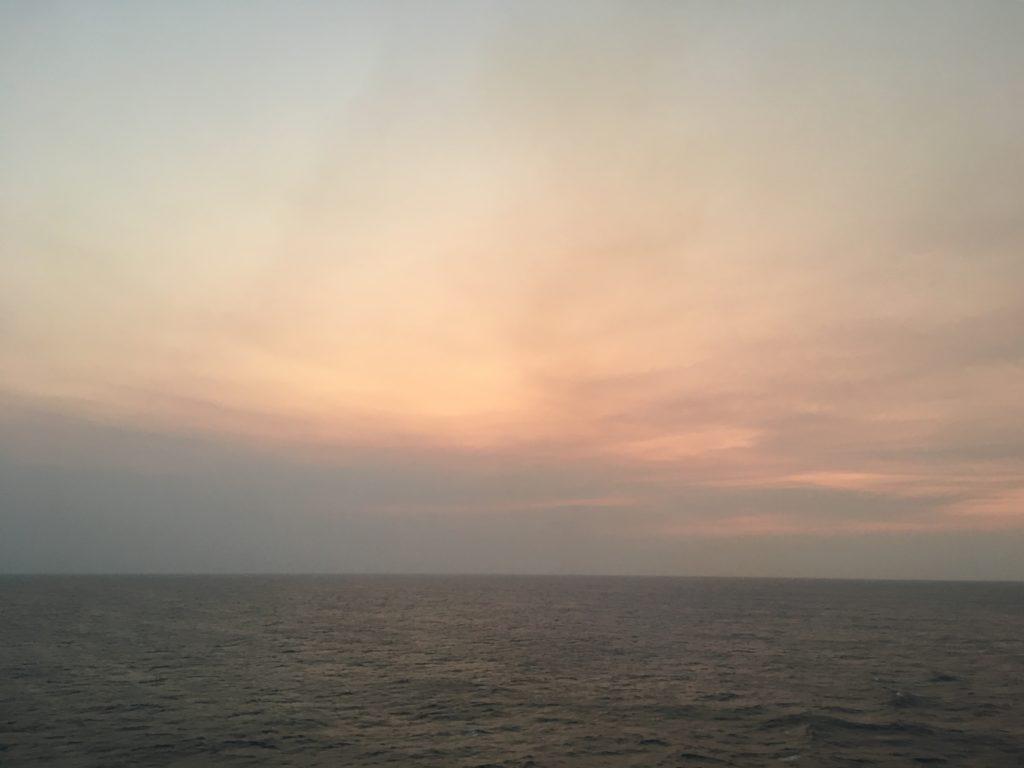 Sun gone smoke remains Coral Sea