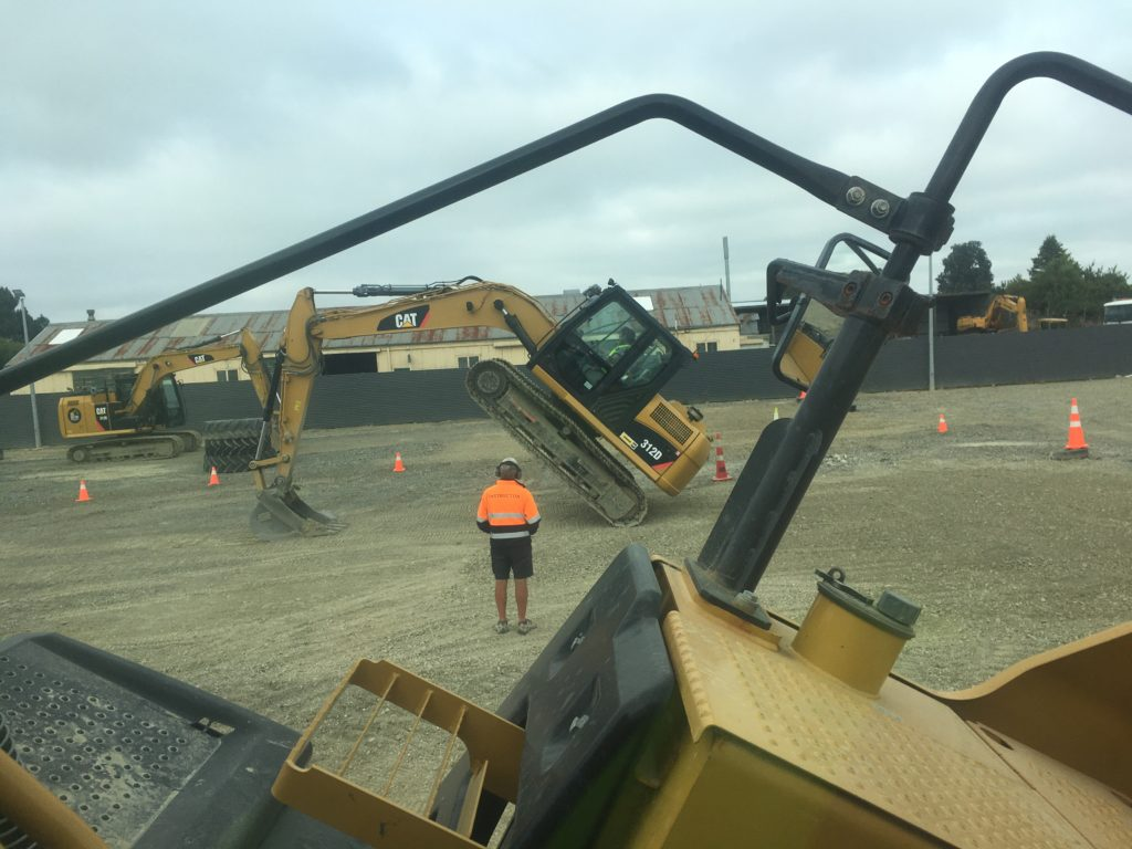 My son in the other digger doing a 'handstand' at Dig This, Invercargill