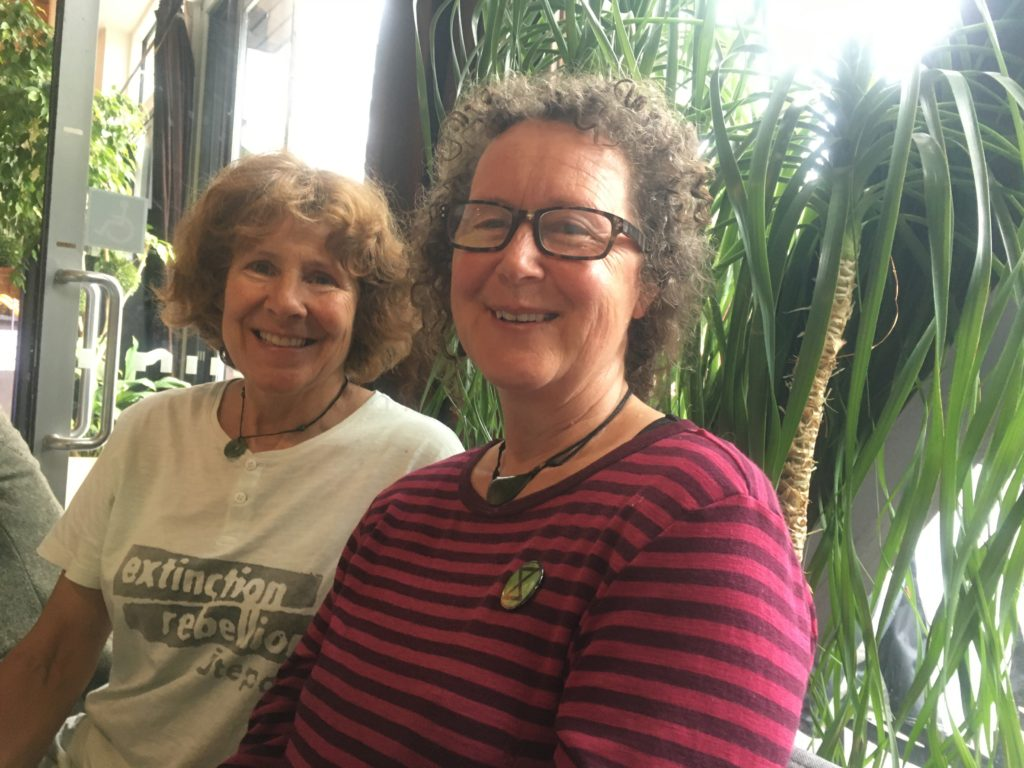 Jen Olsen and Bridget Ellis in Invercargill, protesting future fossil fuel extraction